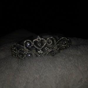 A silver rhinestone crown
